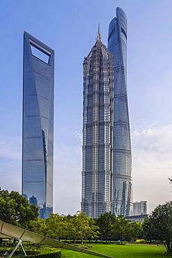 The tallest skyscrapers in the Pudong Special Economic Zone: Shanghai World Financial Center, nicknamed The Bottle Opener at 492 meters, Jin Mao Tower, nicknamed The Syringe at 420 meters, and the 632-meter Shanghai Tower, nicknamed The Twist, Shanghai, People's Republic of China