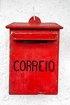 """Vintage mail office box with portuguese word """"""""mail"""""""" on white wall"""