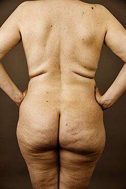 Female nude, back view of an older, thicker woman with wrinkles, studio shot, Germany, Europe