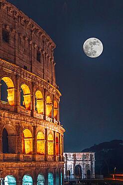 The Colosseum illuminated at night, full moon, Rome, Italy, Europe