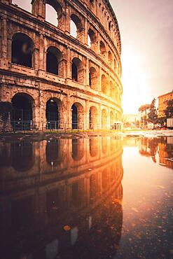 The Colosseum with reflection, puddle, sunrise, Rome, Italy, Europe