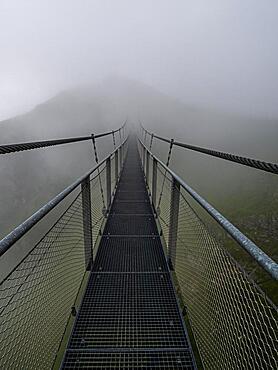 Suspension bridge in the fog, Stubnerkogel, Bad Gastein, Salzburger Land, Austria, Europe