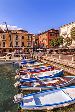 View of boats in Malcesine Harbour by the Lake, Malcesine, Lake Garda, Veneto, Italian Lakes, Italy, Europe