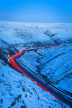 Winter landscape and trail lights on Snake Pass, Peak District National Park, Derbyshire, England, United Kingdom, Europe