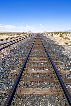 View of railway line close to Highway 15 in California, United States of America, North America