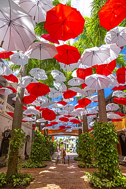 Red and white umbrellas in shopping mall at Holetown, Barbados, West Indies, Caribbean, Central America