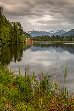 Lake side bar and mountainous backdrop at Schwarzsee near Kitzbuhel, Tyrol, Austria, Europe