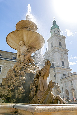 View of Baroque Fountain and Salzburg Cathedral in Residenzplatz, Salzburg, Austria, Europe