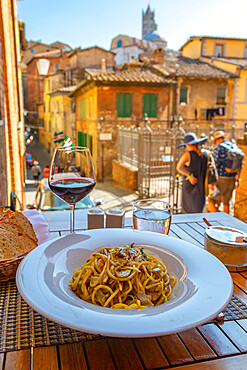 View of traditional Italian cuisine, pasta and wine, Siena, Tuscany, Italy, Europe