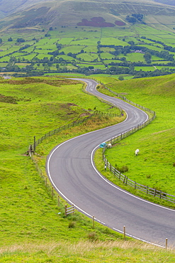 View of winding road toward Edale, Vale of Edale, Peak District National Park, Derbyshire, England, United Kingdom, Europe