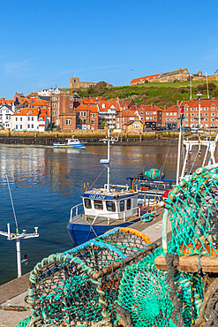 View of St. Mary's Church and fishing baskets, houses and boats on the River Esk, Whitby, Yorkshire, England, United Kingdom, Europe