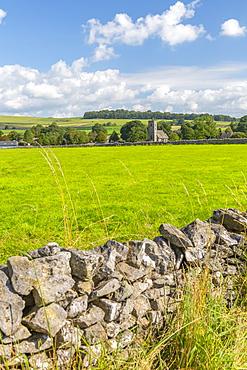 View of village church and dry stone walls, Biggin, Peak District National Park, Derbyshire, England, United Kingdom, Europe