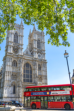 View of traditional red bus and Westminster Cathedral framed by green foliage, Westminster, London, England, United Kingdom, Europe - 844-23663