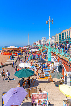 View of sea front carousel and colourful souvenir stalls, Brighton, East Sussex, England, United Kingdom, Europe