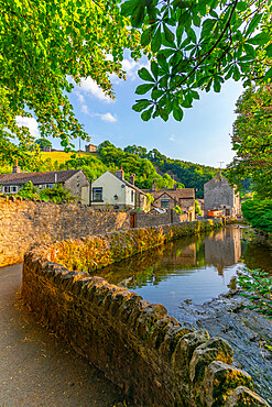 View of Castleton village and stream overlooked by Peveril Castle, Hope Valley, Peak District NP, Derbyshire, England, United Kingdom, Europe