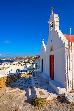 View of white washed chapel overlooking town, Mykonos Town, Mykonos, Cyclades Islands, Greek Islands, Aegean Sea, Greece, Europe
