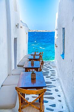 View of sea and restaurant tables in Mykonos Town, Mykonos, Cyclades Islands, Greek Islands, Aegean Sea, Greece, Europe
