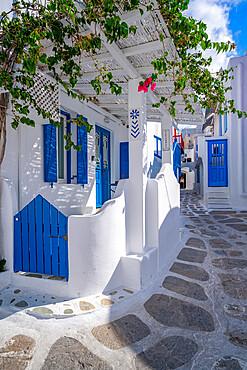 View of girl walking through white washed narrow street, Mykonos Town, Mykonos, Cyclades Islands, Greek Islands, Aegean Sea, Greece, Europe
