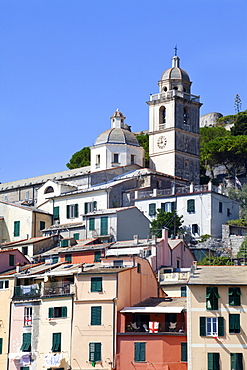 The Church of St. Lawrence sits above colourful buildings at Porto Venere, Cinque Terre, UNESCO World Heritage Site, Liguria, Italy, Europe