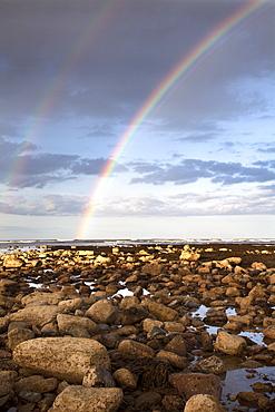 Rainbow over the sea at Robin Hoods Bay, Yorkshire, England, United Kingdom, Europe