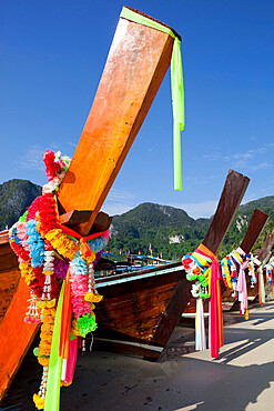 Garlands decorating long-tail boats, Koh Phi Phi, Krabi Province, Thailand, Southeast Asia, Asia