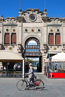 Suited man and bicycle walking past Art Nouveau buildings, Viale Regina Margherita, Viareggio, Tuscany, Italy, Europe