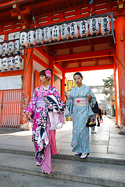 Young Japanese girls in traditional kimonos, Yasaka Shrine, Kyoto, Japan, Asia