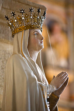 Statue of Virgin Mary wearing crown inside parish church, Saint-Thegonnec, Finistere, Brittany, France, Europe