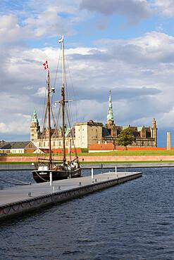 Tall ship in harbour with Kronborg Castle used as setting for Shakespeare's Hamlet, Helsingor, Zealand, Denmark, Scandinavia, Europe