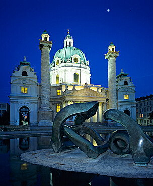 Karlskirche at night with Henry Moore sculpture in foreground, Vienna, Austria, Europe