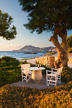 White wine bottle and glasses on table at Nefeli Sunset Studios, Pollonia, Milos, Cyclades, Aegean Sea, Greek Islands, Greece, Europe