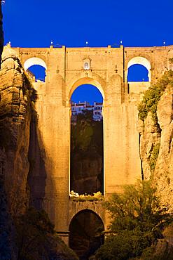 Puente Nuevo (New Bridge) floodlit at night, Ronda, Andalucia, Spain, Europe