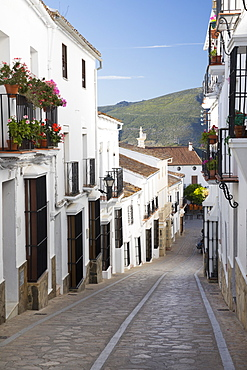 Narrow street in Andalucian white village, Zahara de la Sierra, Sierra de Grazalema Natural Park, Andalucia, Spain, Europe