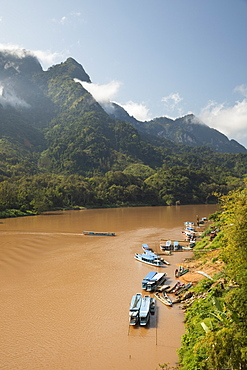 Nam Ou River with karst peaks and lifting mist, Nong Khiaw, Luang Prabang Province, Northern Laos, Laos, Indochina, Southeast Asia, Asia