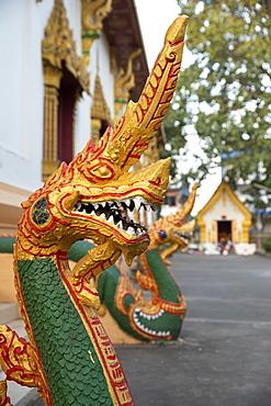 Naga guardian at the Wat Inpeng Buddhist temple, Rue Samsenthai, Vientiane, Laos, Indochina, Southeast Asia, Asia