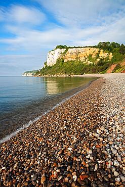 Shingle beach and cliffs of Seaton Hole at high tide, Seaton, Jurassic Coast, Devon, England, United Kingdom, Europe