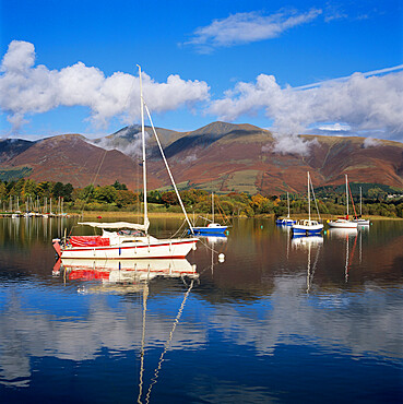 Yachts moored in Derwent Water in autumn morning sunlight, Keswick, Lake District, UNESCO World Heritage Site, Cumbria, England, United Kingdom, Europe
