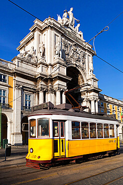 Tram (electricos) below the Arco da Rua Augusta in Praca do Comercio, Baixa, Lisbon, Portugal, Europe