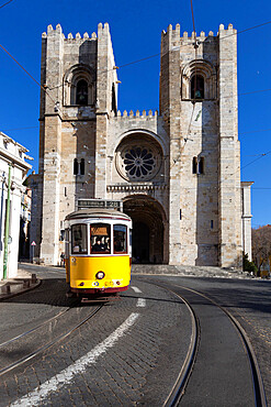 Se Cathedral and tram (electricos), Alfama, Lisbon, Portugal, Europe