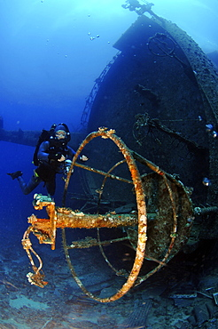 Mixed gas rebreather diver by crows nest of wrecked ship on seabed.  Red Sea.