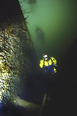 Diver alongside German Light Cruiser Dresden II, Scapa Flow, Orkney islands, Scotland, UK