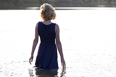 Beautiful woman standing in lake