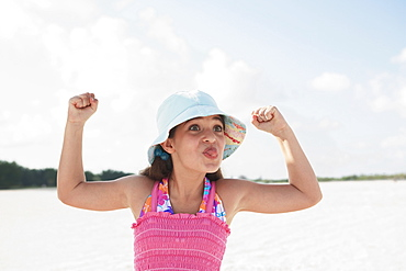 Girl at beach making funny face