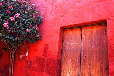 Red wall and doors of Monastery Santa Catalina, Arequipa, Peru
