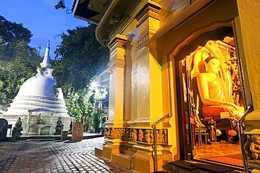 Budda statue in Gangaramaya Temple, Colombo, Sri Lanka
