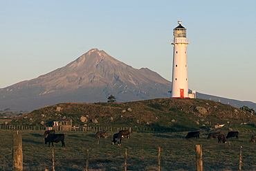 Mount Taranaki and lighthouse at sunset, New Zealand
