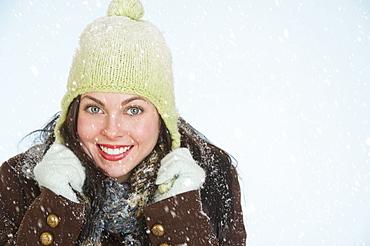 Studio portrait of woman in winter clothing