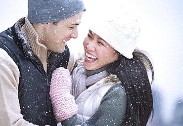 Couple wearing warm clothing having fun outside