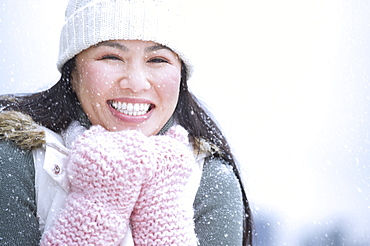 Portrait of happy woman wearing warm clothing