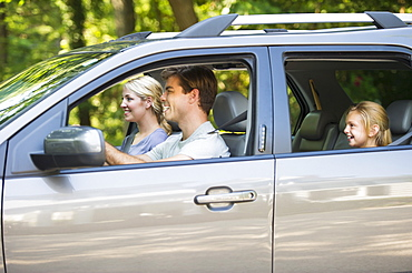 Parents with daughter (10-11) driving car